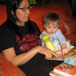 mom and baby reading